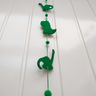 Green felt dinosaur wall hanging