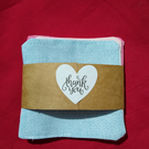 Set of three 9cm square reusable cloth face wipes.