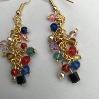 A pair of multi coloured gold wire earrings