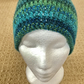 Women's green teal marble crotchet beanie.