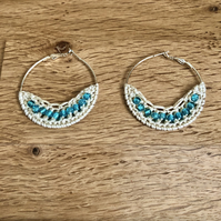 """Hello March"" Silver plated hoop earrings with crochet and aqua design."