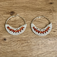 Hello November...silver plated hoop earrings with crochet and topaz design.