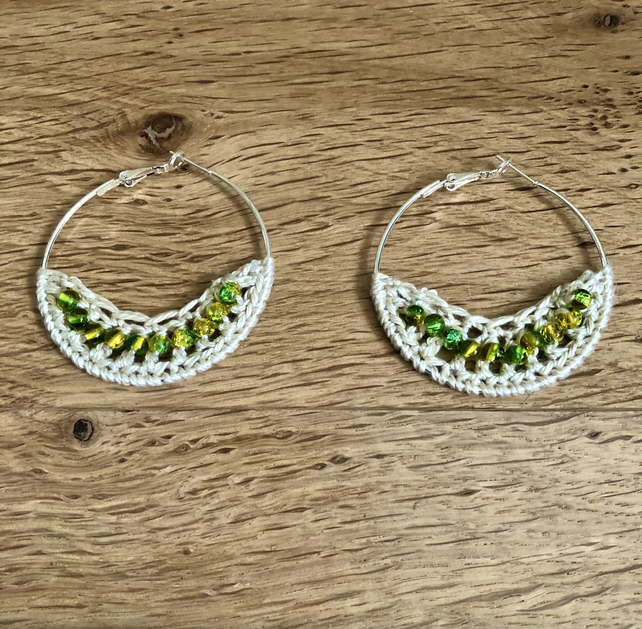 Hello August....Silver plated earrings with crochet and peridot design.