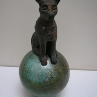 EGYPTIAN CAT BASTET SITTING ON A BALL
