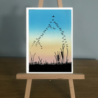 Blank Card -  Migration showing birds flying in a v shape across a sunset sky.