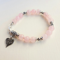Bohemian styled Rose Quartz bracelet with a heart charm dangle