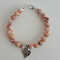 Red Griotte natural gemstone bracelet with a heart charm dangle
