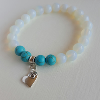 Moonstone and Turquoise gemstone bracelet with little heart charm. Stretchable.