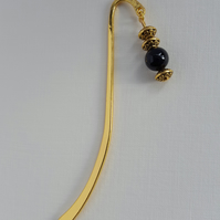 Gold plate bookmark with black Onyx dangle. Qur'an mark.
