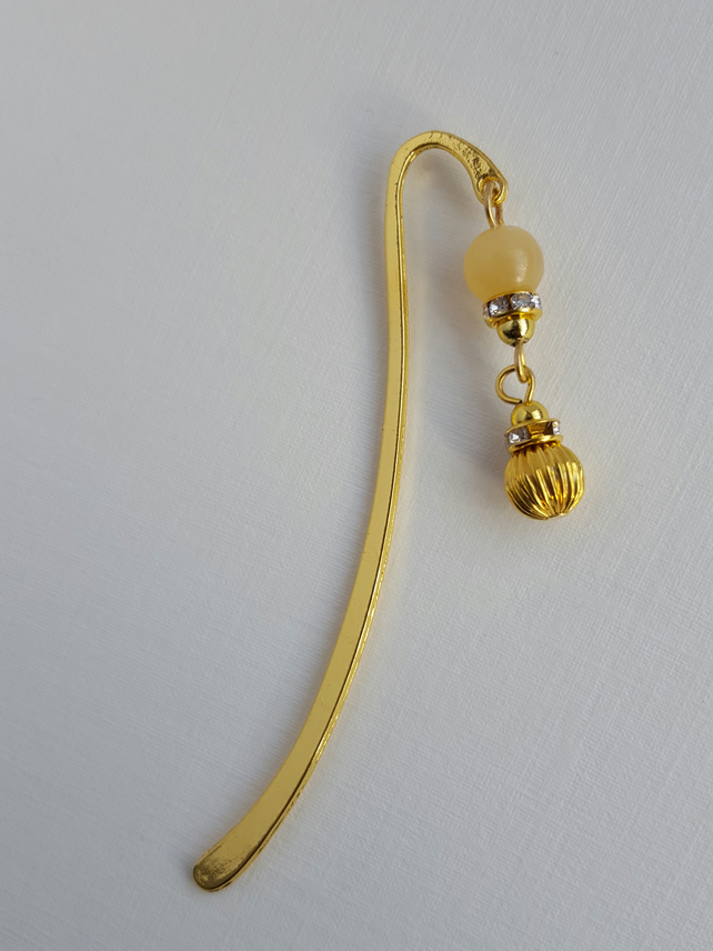 Gold plate metal bookmark with yellow Jade charm. Quran mark