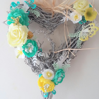Flower decorated wicker heart