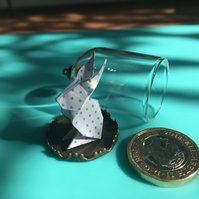 Tiny origami bunny and glass dome