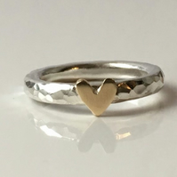 Silver ring with gold heart