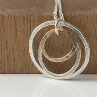Silver and gold circle pendant