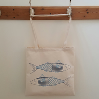 Fish in a jumper tote bag
