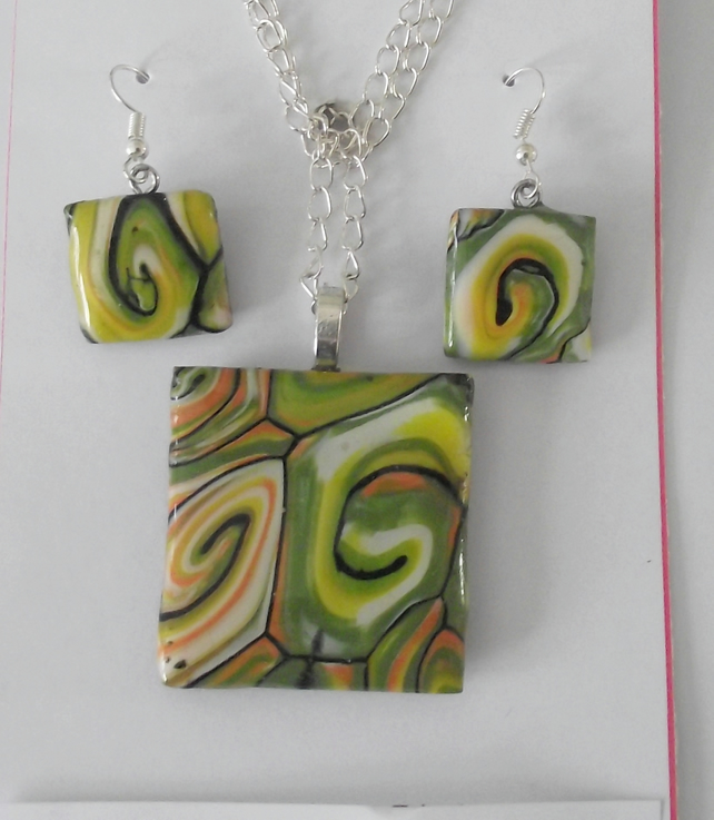 Modern handmade square pendant set in polymer clay