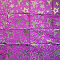 Large sheet purple tissue paper linoprinted with gold stars