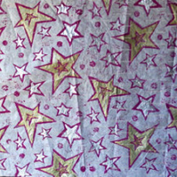 Sheet of white tissue paper linoprinted with stars design