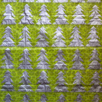 Large sheet of green tissue paper linoprinted in silver trees