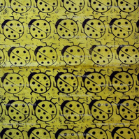 Large sheet of yellow tissue paper, linoprinted with ladybugs