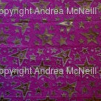 Sheet of fuschia tissue paper handprinted with stars linoprint