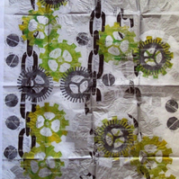 Sheet of white tissue paper with linoprinted Steampunk design
