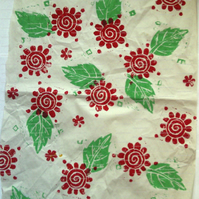 Sheet of white paper handprinted with leaf and flower design