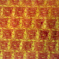 Sheet of yellow tissue paper, linoprinted in abstract flower