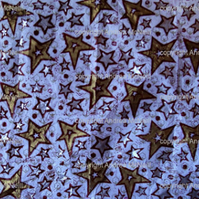 white tissue paper with linoprinted stars