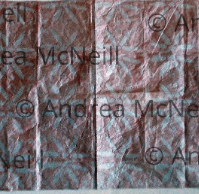 Sheet of silver tissue paper with copper linoprint