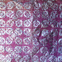 Sheet of pink tissue paper, silver tribal linoprint design