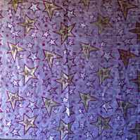 Sheet of pale pink tissue paper, linoprinted with stars