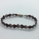 Cranberry and silver beaded hearts bracelet