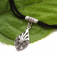 Black cord silver tone deco pendant necklace