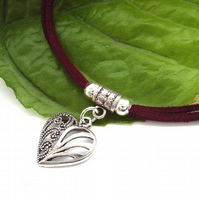 Silver tone heart cord necklace