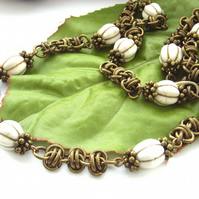White magnasite bead barrel link chain maille necklace in antique bronze