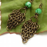 Chain maille triangle earrings with green glass beads