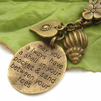 Stamped word bag charm with seaside motto and shell charm