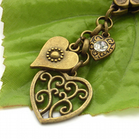 Three hearts beating as one vintage style bag charm