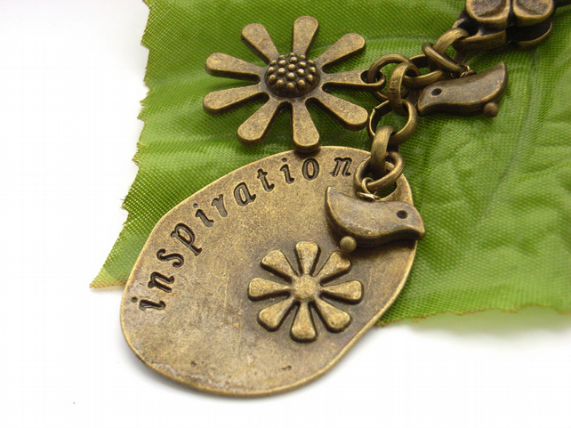 Inspiration stamped word vintage style bronze bag charm with bird and flower