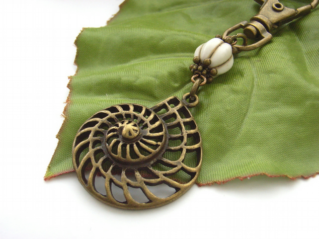 Ammonite fossil purse charm