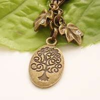 Tree of life and crystal leaf bag charm