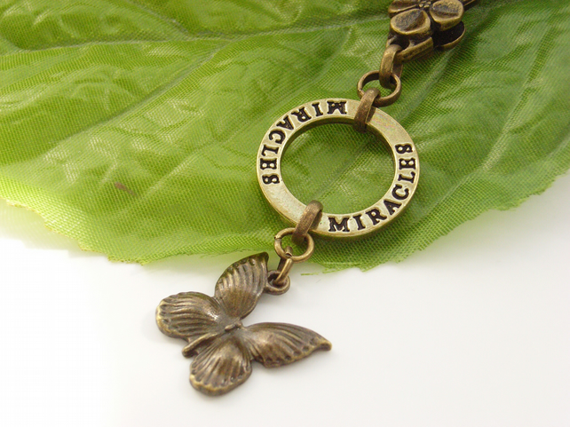 Vintage style bag charm miracles and butterfly
