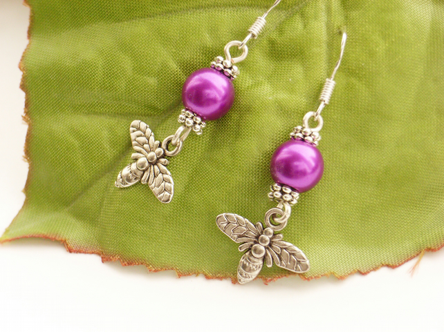 Bee charm earrings with sterling silver ear wires and purple faux pearls