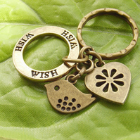 Bird, heart and stamped Wish affirmation keyring in vintage bronze