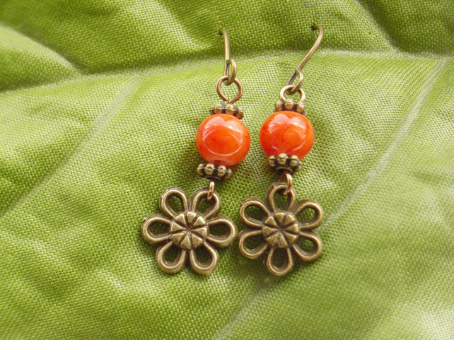Flower charm earrings with orange glass beads