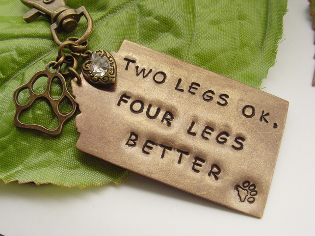 Hand stamped word dog pet bag or purse charm Two legs OK Four legs better