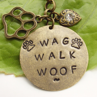 Hand stamped word dog pet bag or purse charm Wag Walk Woof