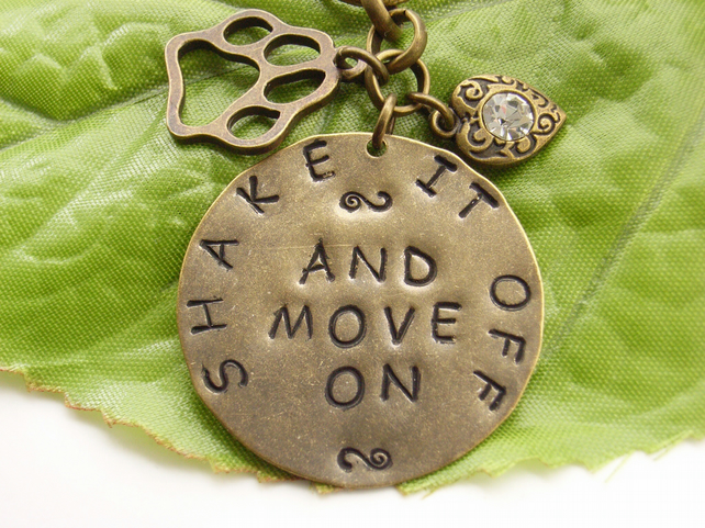 Hand stamped word dog pet bag or purse charm Shake it off and move on