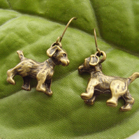 Dog earrings in bronze